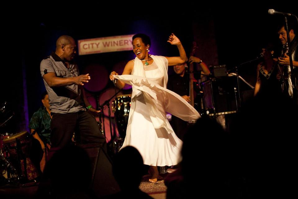 Afro-Peruvian artist Susana Baca, dancing here with fellow Peruvian artist Huevito, performs at City Winery in Manhattan.